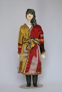 Doll gift porcelain. Traditional Tajik wedding men's suit