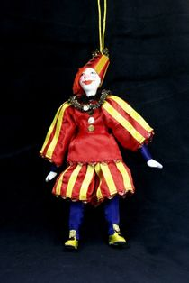 Doll pendant souvenir porcelain. The clown in the striped outfit. Scenic character.