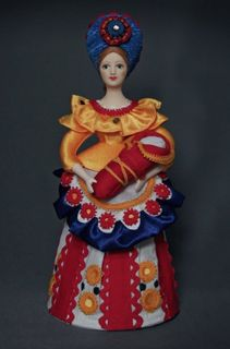 Doll gift porcelain. Nanny with a child. In explanation Dymkovo toys. Russia.