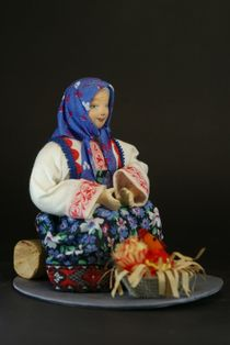 Doll gift porcelain. The old woman in peasant clothes with a hen. Fairy tale character.
