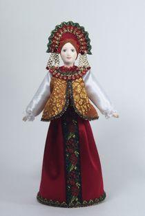 Doll gift porcelain. Traditional festive maiden costume.