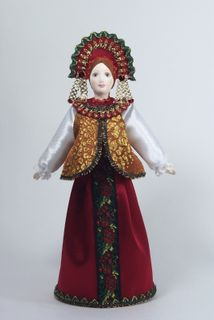 Doll gift porcelain. Traditional festive maiden costume.