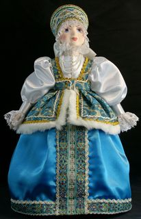 Souvenir doll on kettle - Russian traditional costume