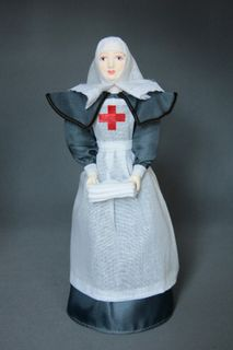 Doll gift porcelain. The sister of mercy. Shaped dress. Late 19th-early 20th century Russia.