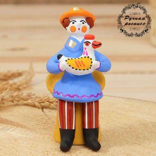 Dymkovskaya earthenware toy Muzhik with the duck