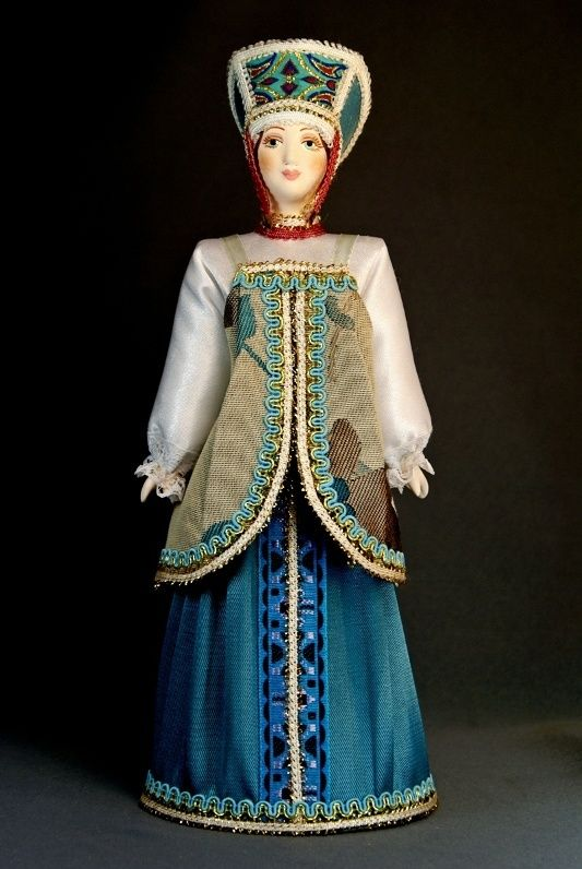Doll gift porcelain. Traditional girl suit.