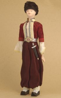 Doll gift porcelain. Crimea. Russia. Tatar youth costume. Late 19th - early 20th century.