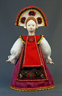 Doll gift porcelain.Girl in the national summer suit (styling). Russia. Late 19th - early 20th century