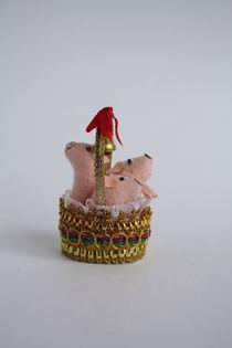 Souvenir doll. Pigs in a basket. Textile.