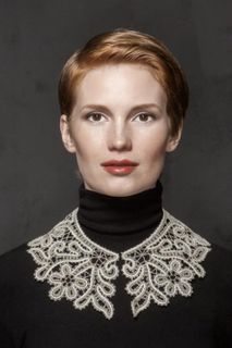 The lace collar round the neck with flowers and twigs