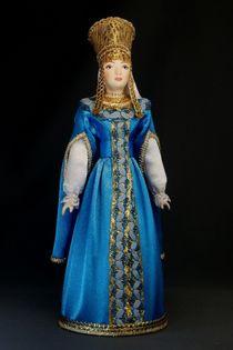 Doll gift porcelain. The boyar's daughter in festive costume.