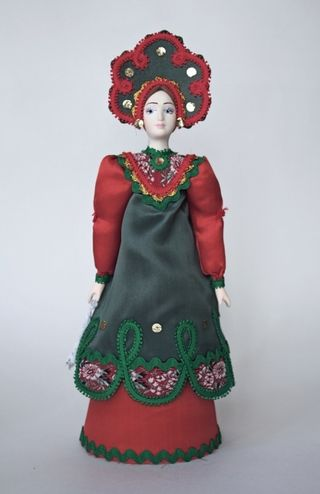 Doll gift porcelain. Russian suit (styling).