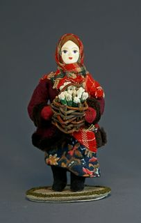 Doll gift porcelain. Girl with a basket of snowdrops. Fairy tale character.