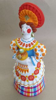 Dymkovo clay toy Lady peasant with a loaf