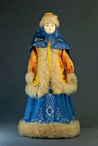 Doll gift porcelain. Yenisei province. Russia. Winter suit rich townswoman. The beginning of the 20th century.