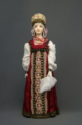 Doll gift porcelain. Russian girl in national costume (styling).