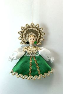 Doll pendant souvenir porcelain. A girl in a lacy soulful.