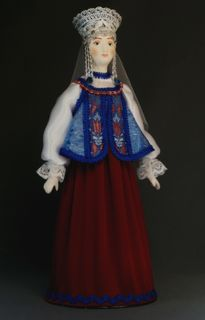Doll gift porcelain. Vologda lips. Russia. Maiden costume. Late 19th - early 20th century.