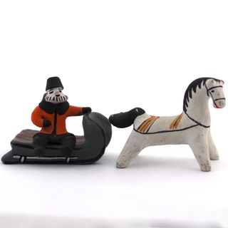 Kargopol clay toy little man on a sled