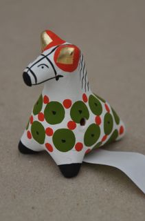 Whistle horse with a green pattern, Dymkovo toy