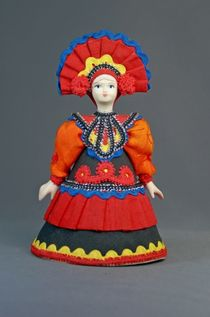 Doll gift porcelain. Folk costume by Dymkovo reasons. Russia.