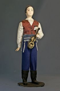 Doll gift porcelain. Costume of a young Jew with a violin.