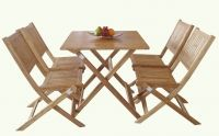 a set of wooden furniture of table and 4 chairs