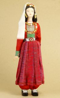 Doll gift porcelain. Crimea. Russia. Tatar maiden in traditional costume. Late 19th - early 20th century