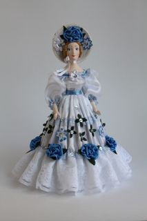 Doll gift porcelain. The lady in secular satin summer dress. The 2nd half of the 19th century.
