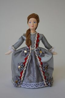 Doll gift porcelain. Girl in court dress. The beginning of the 18th century.