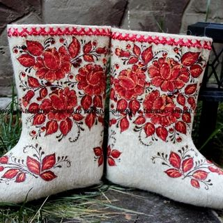 Women's felt boots made of natural sheep wool with painting