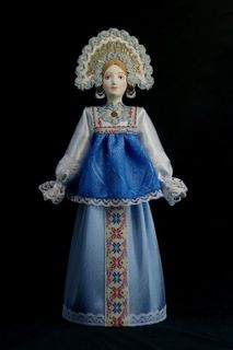 Doll gift porcelain. Traditional maiden costume.Russia