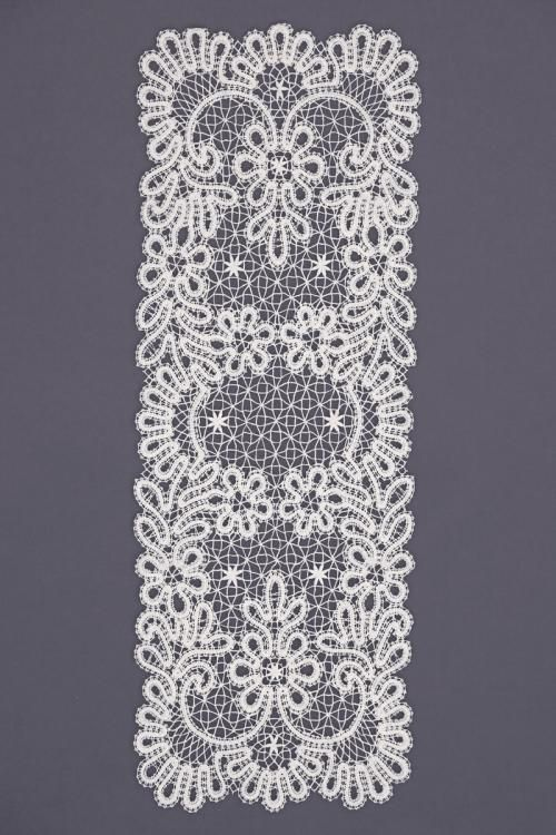 Carpet lace rectangular with stylized vegetable ornament