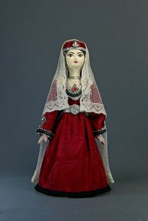 Doll gift porcelain. Armenian traditional female costume. Late 19th - early 20th century.