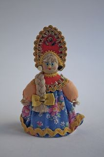 Doll-poteshka gift. Girl in a folk costume. Wood, textiles.