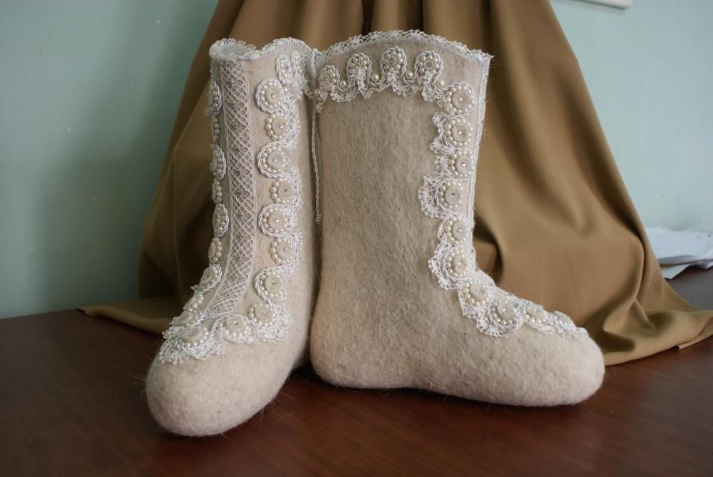 Boots decorated with handmade lace and decorative twisted cord