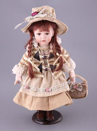 Porcelain doll in the beige hat