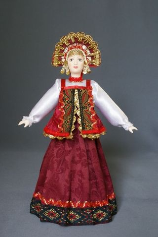 Doll gift porcelain. Girl in a stylized Russian costume