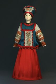 Doll gift. Doll gift porcelain. The North Of Russia. Traditional girl suit. Late 19th - early 20th century