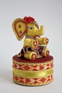 Doll gift. Box. Elephant. Textiles.