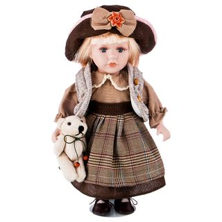Porcelain doll in a brown hat
