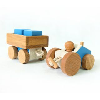 Children's wooden toy tractor with a trailer