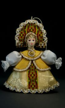 Doll pendant souvenir porcelain. The girl is in the heart.