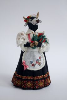 Doll gift. The cow in hat with a bouquet of flowers. Textiles.