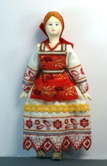 Doll pendant souvenir porcelain. Alyonushka. Maiden traditional costume. Russia.