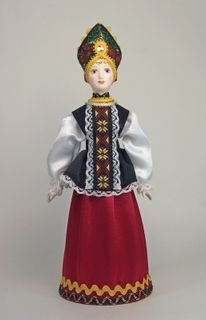 Doll gift porcelain.Traditional maiden costume. Russia
