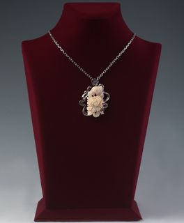 Peony pendant from mammoth tusk