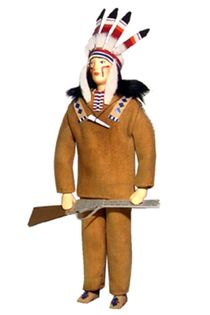 Doll gift. An Indian with a gun. 19th century. North America. The national costume.