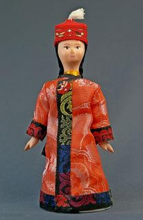 Doll gift porcelain. Kyrgyzstan. The southern districts. Girl in traditional costume. K. 19-B. 20.