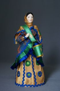 Doll gift porcelain. Peasant woman with a yoke on the motifs painted Dymkovo toys